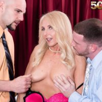 Hot mature blonde Chery Leigh sucks a couple of younger men's cocks at once