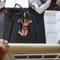 Hot MILF Gabriella Paltrova holds her phat ass while fucking on a sex swing