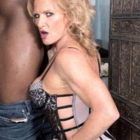 Mature blonde Amanda Verhooks greets her younger black lover in hot lingerie