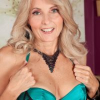 Mature blonde Chery Leigh seduces her younger lover in hot lingerie and stockings