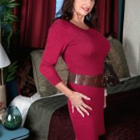 Mature lady Ciara is stripped to her bra and panties in a bedroom by her lover