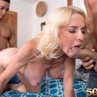 Over 50 blonde MILF Cammille Austin is freed from pink lingerie before MMF sex