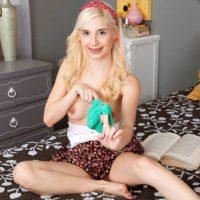 Petite blonde teen Piper Perri flashes her panties before exposing her small boobs