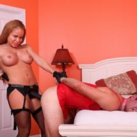 Redhead wife Nikki Delano fucks her sissy boy in the ass with a strapon cock in nylons
