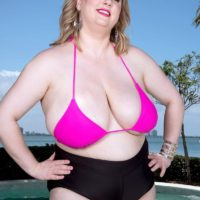 Sexy BBW Laddie Lynn releases her huge natural tits from a bikini top out by the pool