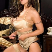 Solo girl Eva Notty removes a tight skirt to model non nude in lingerie and nylons
