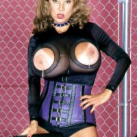 Solo girl Minka shows off her huge boobs in a cupless bodysuit and a waist cincher
