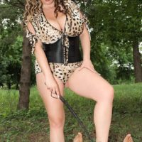 Thick MILF Jana wields a crop while unleashing hooters during an outdoor handjob