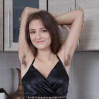 Amateur model Shivali eats a watermelon while showing her hairy armpits and beaver