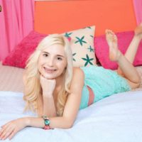 Flexible blonde teen Piper Perri takes hold of a large cock after baring her boobs