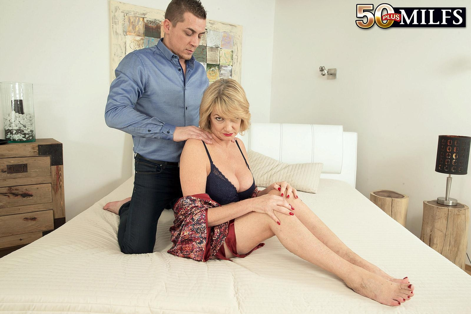 Mature blonde lady Amy goes topless after being fed berries and receiving a neck rub