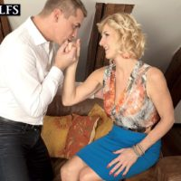 Over 50 blonde Molly Maracas uncovers her big boobs before licking a cock on knees