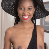 Thin ebony amateur Saf spreads her natural pussy while wearing a sun hat and heels