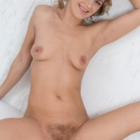 Blonde amateur Ayda licks her lips prior to a close up of her finger spread pussy