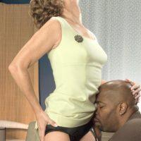Leggy granny Avalynne O'Brien flashes upskirt panties while seducing a black man