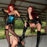 Alexia Jordon and Amadahy Mistrix are joined by a third domme during CFNM play