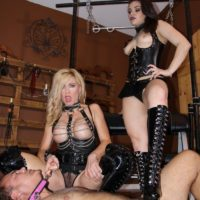 Kimber Woods and Parker trample a naked man while wearing long black boots