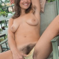Amateur solo girl Katie Z shows her hairy underarms and beaver on her balcony
