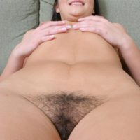 brunette amateur touts her phat ass before showing the pink of her trimmed pussy