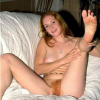 Caucasian amateur puts her ginger pussy on display while totally naked by herself