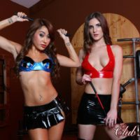 Hot girls Dava and Molly model fetish wear amid BDSM gear while in a dungeon