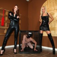 Hot girls Zoey and Kendra tease a male slave's hard cock before putting him in a cage