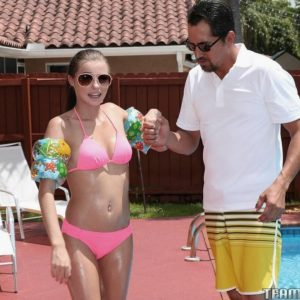 teen pornstar Carolina Sweets partakes in rough sex while in a swimming pool