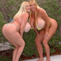Big boobed blonde Kayla Kleevage and a similar shaped lesbian kiss while in a pool