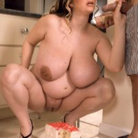 Big titted BBW April McKenzie eats slices of cake while riding her man's cock