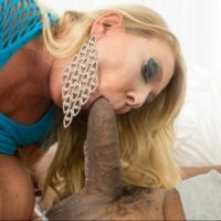Big titted blonde woman Kayla Kleevage exchanges oral sex before interracial fucking