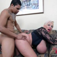 Big titted platinum blonde Claudia Marie partakes in interracial sex on a couch