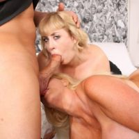 Mature blonde BBW Kayla Kleevage and a girlfriend take part in a threesome on a bed