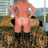 Mature blonde Kayla Kleevage takes self shots of her tan lined ass in black stockings