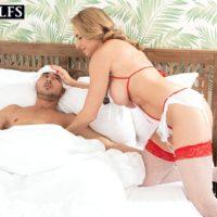 Older blonde Kenzi Foxx seduces an ill young man while wearing naughty nurse attire