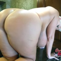 Older platinum blonde Claudia Marie wets her massive breasts while taking a shower