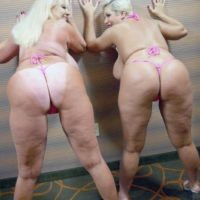 Pornstars Kayla Kleevage and Claudia Marie share a lesbian kiss after modeling bikinis
