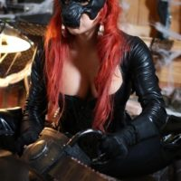 Solo model Karen Fisher frees her big tits and butt from latex clothing at Halloween