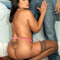 Asian granny Lani Maru exchanges oral sex favours with her much younger Latino lover on a bed