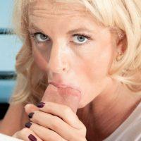 Athletic blonde granny Samantha Ray sucks a boy's big cock in a gym locker room