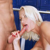 Athletic mature blonde Lavita sucks her trainer's large cock during a workout
