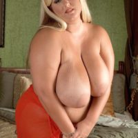 Blonde BBW Rose Valentina baring gigantic breasts from sundress after an upskirt panty show
