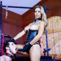 Blonde bossy type Alexis Fawx face screwing her sissy husband with a strap on penis in latex boots