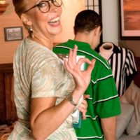 Blonde GILF Erica Lauren seduces a young lad during no panty upskirt action