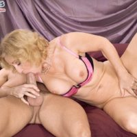 Blonde granny Cee Cee chokes on her young lover's big cock during a blowjob