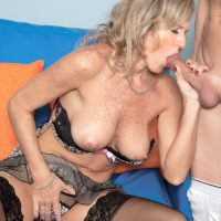 Blonde granny Jade gives a young man a BJ after her plays with her nipples