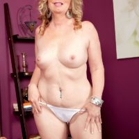 Blonde MILF Summer Sands strips naked before licking and jerking on a large cock