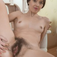 Brunette amateur Lisa Carry freeing hairy gash and taut booty from undies