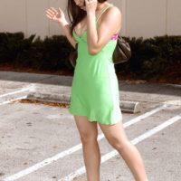 Brunette teen Missy Vega models in a parking lot before hardcore sex in a bathroom