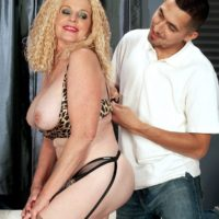 Busty blonde granny Charlie sports curly hair while partaking in foreplay with her Latino toy boy