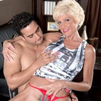 Busty blonde granny Niki parks her petite body on a young Latino boy while seducing him